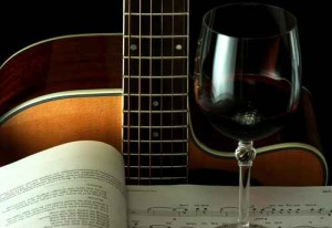 Guitar, book and wineglass